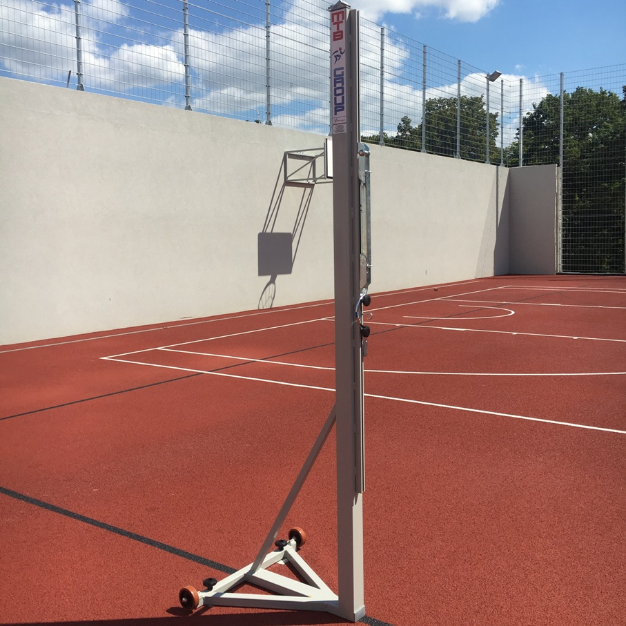 Steel volleyball posts on metal frame