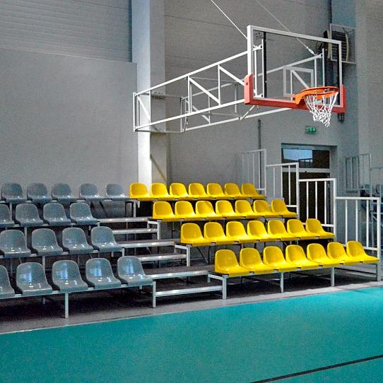 Stable tribune with plastic seats