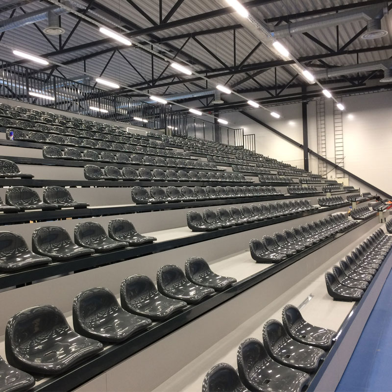 Electric folding bleacher with plastic seats or bench