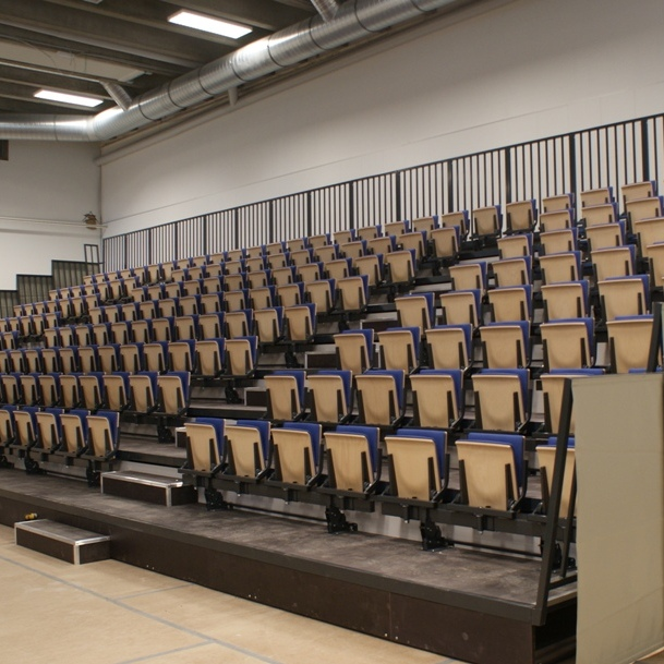 ELECTRIC FOLDING BLEACHER WITH GRAVITATIONAL FOLDING SEATS